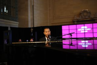 John Legend Performing in the Courtyard Refresthing Business Lobby Replica in Grand Central Terminal