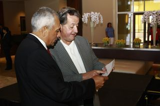 Herve Humler Reviewing Training Agenda with a Ritz-Carlton Gentleman