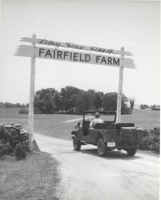 Fairfield Farm entrance sign with Jeep